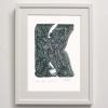 K for Kuri Framed Print