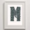M for Mana Framed Print