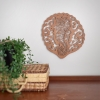 Manaia rimu lasercut in situ beside plant and basket